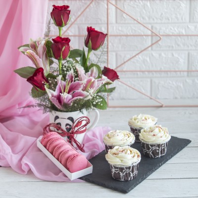 4 Red velvet Cup Cakes , Box  of 5 macarons and Arrangement of Red Roses and lilies in a mug