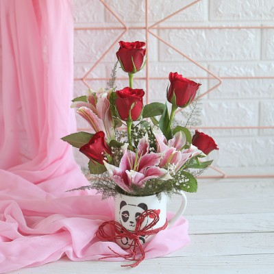 Arrangement of Red Roses and lilies in a mug