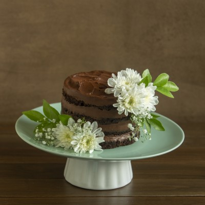 Dark Chocolate cake with Belgian Chocolate Frosting  750gms and white Chrysanthemums