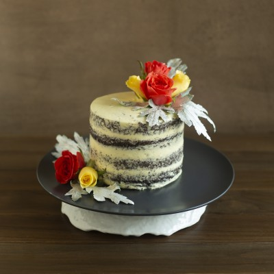 Chocolate sponge  with French vanilla butter cream ,with Orange and Yellow Roses  800gms