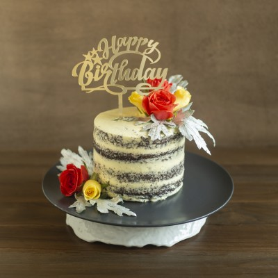 Chocolate sponge  with French vanilla butter cream ,with Orange and Yellow Roses  800gms with Happy Birthday topper