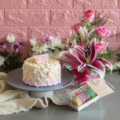 Shaded Purple Rosette cake (Dutch truffle)750gms,Box of 5 assorted Macarons, Arrangement of Lilies & Pink Roses in a mug
