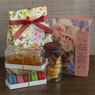 Multigrain cookies ,almond bar cake ,box of 5 Assorted Macarons  and a Congratulations Card [Contains Egg]