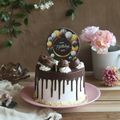 Chocolate Bounty cake 750gms with Black  printed balloon Happy Birthday topper