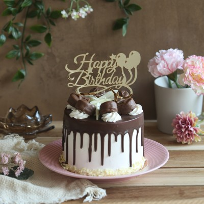 Chocolate Bounty cake 750gms with  Happy Birthday  balloon topper