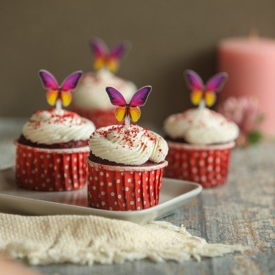 Red velvet cupcakes with butterfly toppers