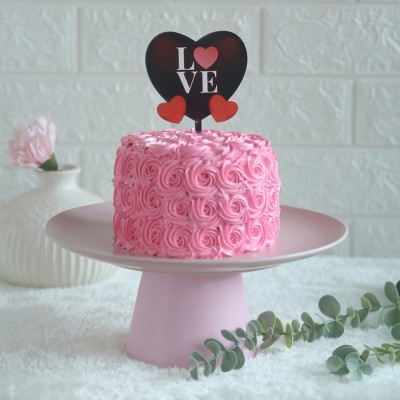 Pink Rosette cake 750gmswith love hearts  topper