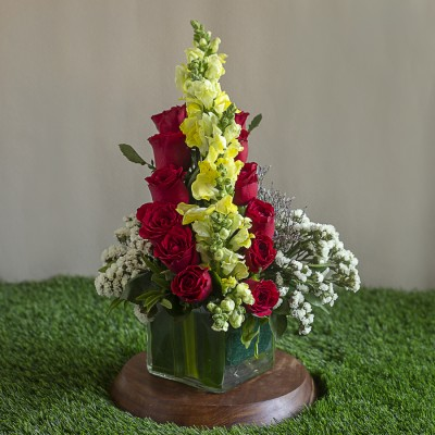 Snap Dragon ,Red Roses, lavenders and Limonium in a Square Vase