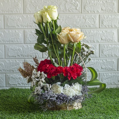Peach Roses, Red and White Carnations , Dry Sticks and Statis in a Basket