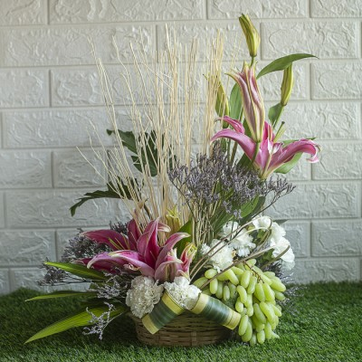 Lilies , Dry sticks and White Carnations with Grapes