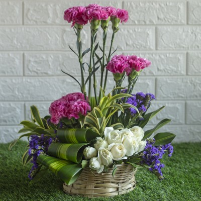 Pink Carnations , White Roses and  purple Statis in  a Basket