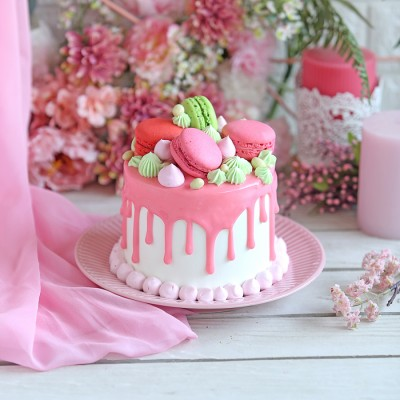 Pink Frosting Cake with macarons on top750gms