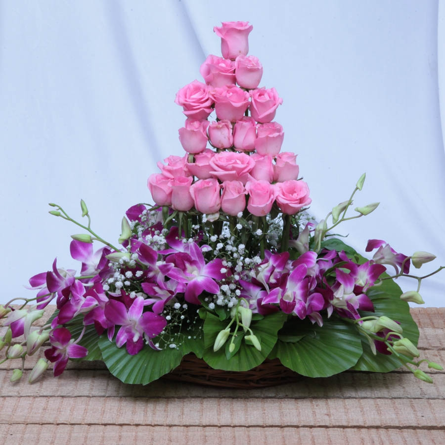 basket of orchid and pink flowers