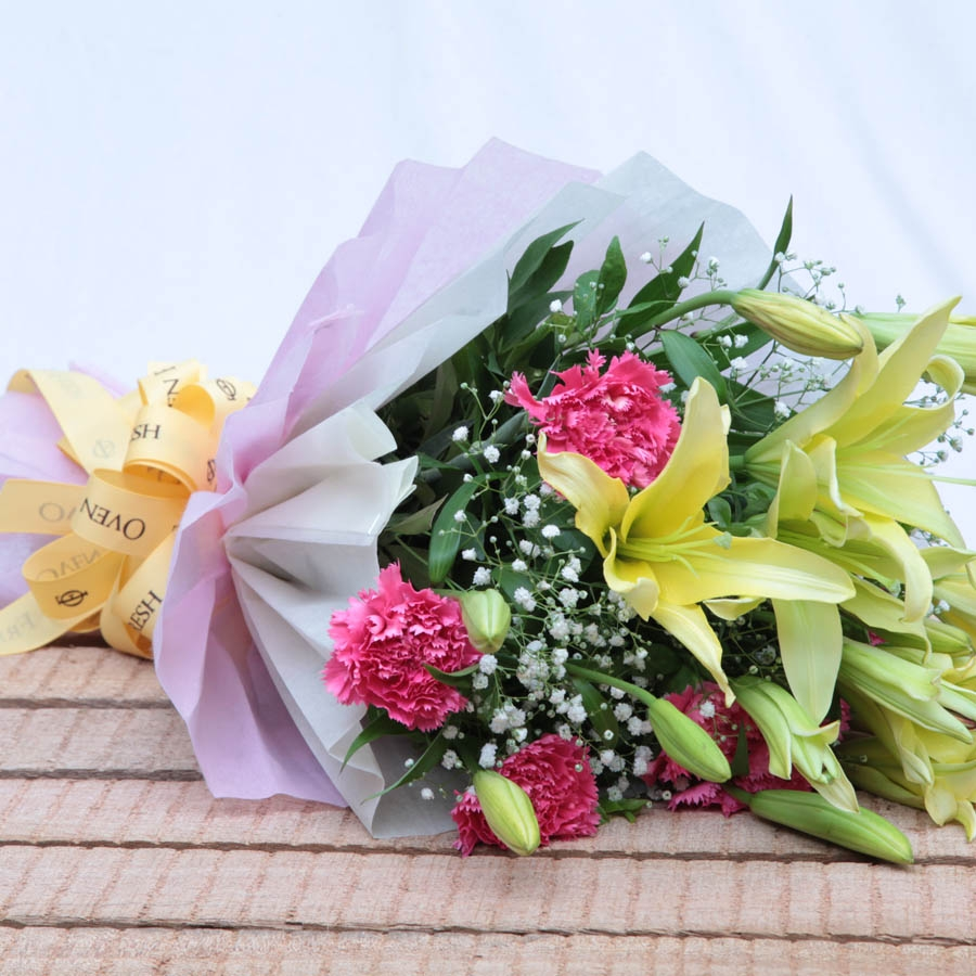 Bouquet of pink carnations and lillies flowers