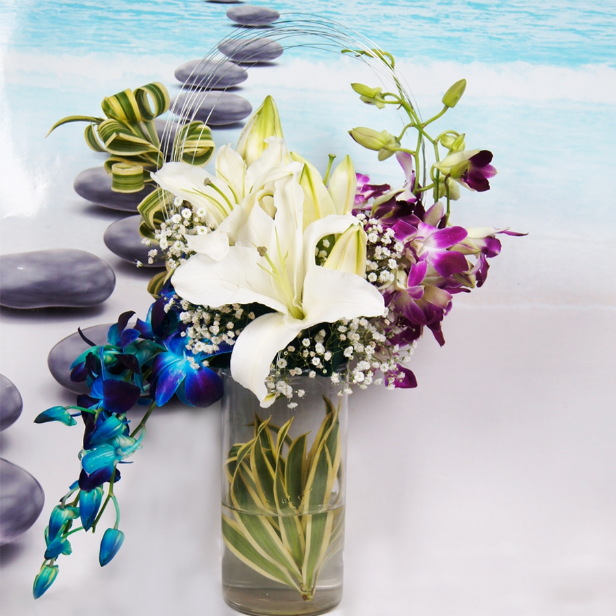 Cylinder jar with orchids and lilies