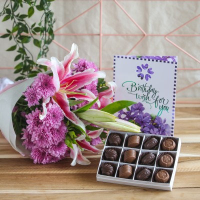 Box of 12 Chocolate Pralines , bouquet of lilies and  chrysanthemum  and birthday card