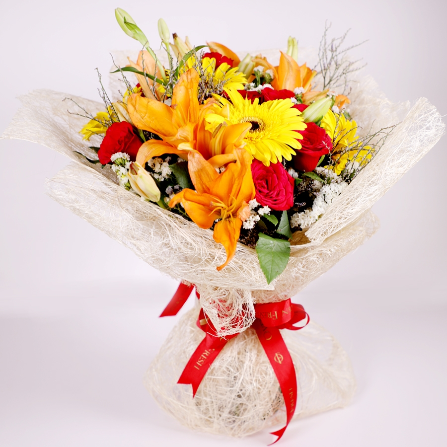 Jute bouquet with orange lillies and yellow gerbera