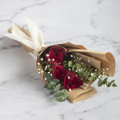 Hand Bouquet Of Red Roses And Eucalyptus