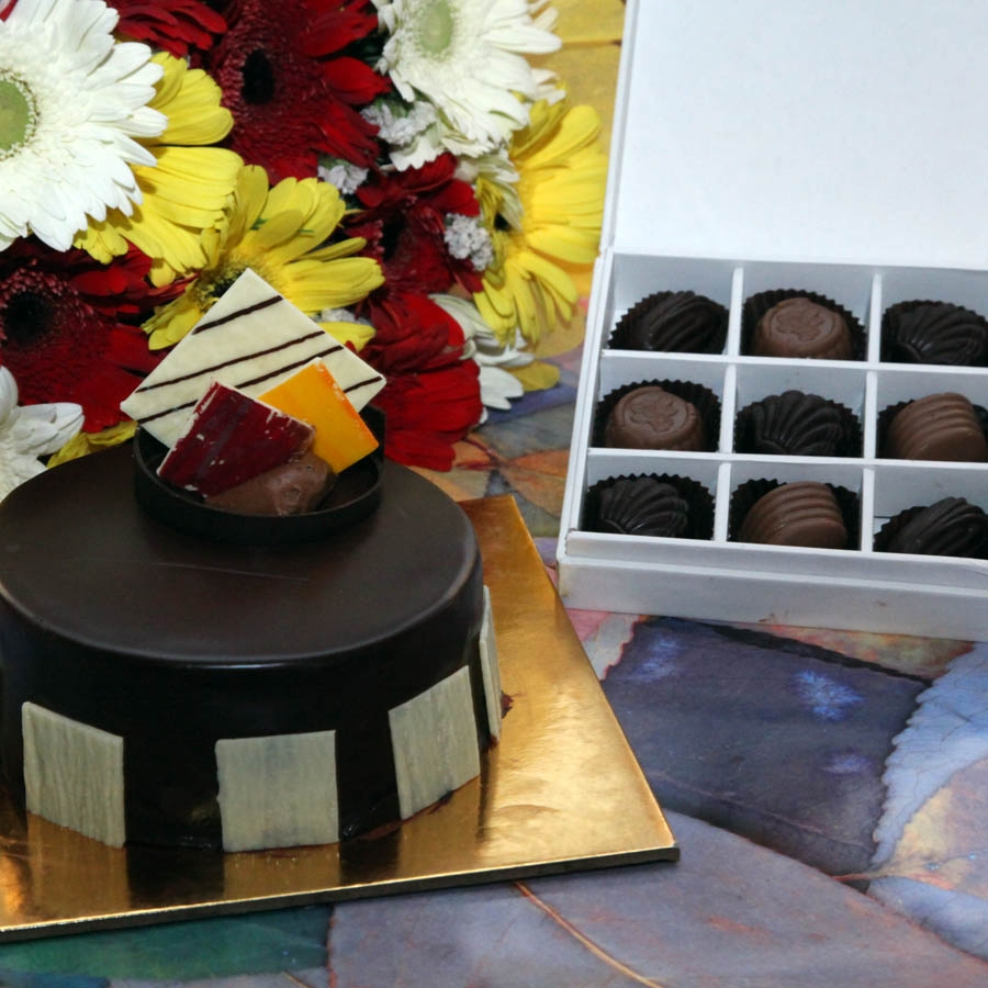 Royale Chocolate Mousse 500gms,hand bouquet of gerbera and box of 9 chocolate pralines