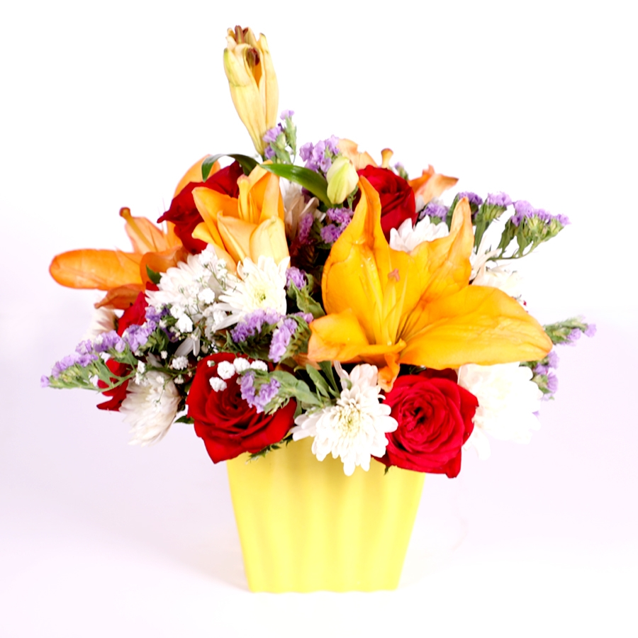 Vase of orange lillies and white daisy